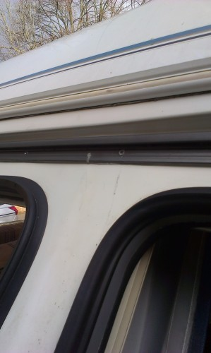 Rail & New Seal Attached to Caravan. Full Seal right to the top, all screws tight to ensure a good seal.