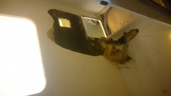 Toilet Removed Damaged Wall Starting to Show. More Stripping Required to See Full Extent Of Damage.